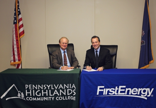 Photo includes Dr. Walter Asonevich (left), President of Pennsylvania Highlands Community College, and David J. Karafa (right), President, Pennsylvania Operations of FirstEnergy, as they sign the agreement to create the Electric Utility Technology partnership