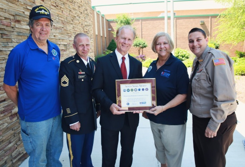 Photo is of the Seven Seals Award presentation. Pictured from left to right: Greg Simmons, ESGR volunteer; Scott Mognet, student and retired from the PA Army National Guard; Dr. Walter Asonevich, College President; Polly Simmons, ESGR volunteer; and Chris Schuerch, student and Windber VFW Post 4795 member.