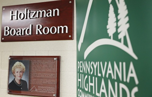 New signage outside of the College's Holtzman Board Room.